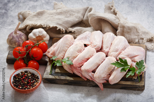 fresh chicken wings with ingredients for cooking - 225212714