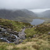 Landscape image of Llyn Idwal in Glyders mountain range in Snowdonia during heavy rainfall in Autumn - 225220531