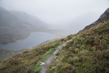 Landscape image of Llyn Idwal in Glyders mountain range in Snowdonia during heavy rainfall in Autumn - 225220552