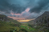 Beautiful dramatic landscape image of Nant Francon valley in Snowdonia during sunset in Autumn - 225221123