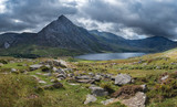 Stunning panoramic landscape image of countryside around Llyn Ogwen in Snowdonia during early Autumn with Tryfan in background - 225221366
