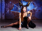 model wearing Halloween costume of leather and horns - 225224102