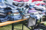clothing collection like jeans, shirts and sweaters for the indigent or for sale at a flea market - 225225124