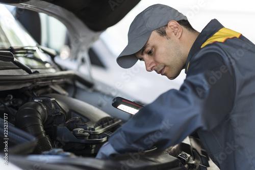 Mechainc fixing a van engine - 225237177