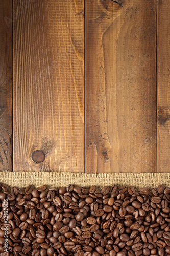 Wall mural coffee beans on wooden background