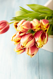 Bunch of Tulips on a Tray. Flower background. Wooden background. Copy space. - 225284534