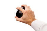 Strong male hand holds black sphere