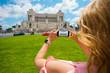 Tourist woman taking photo in Roma, Italy