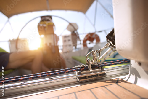 Sailor relaxing in his sailboat at sunset