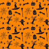 Seamless vector pattern with hand drawn doodle halloween symbols