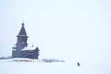 lonely wooden church in the field / concept faith, god, loneliness, architecture in the winter landscape - 225303128