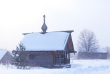 wooden church in Finland / winter landscape in Scandinavia view of the wooden church, old architecture - 225303355