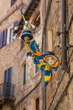 Siena Italy July 1st 2015 : Palio flag and ornate lighting in a  street in Siena, Tuscany