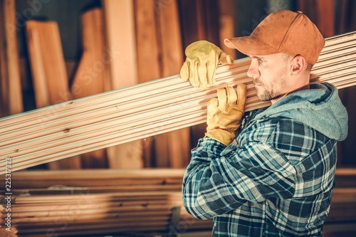 Worker with Wood Planks - 225317323