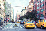 Traffic on Manhattan's avenue  ( Ladies' Mile Historic District) in the day-time, New York City,  United States.  Toned image. - 225331954
