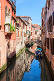 Typical view on the narrow canal in Venice, Italy. - 225332100