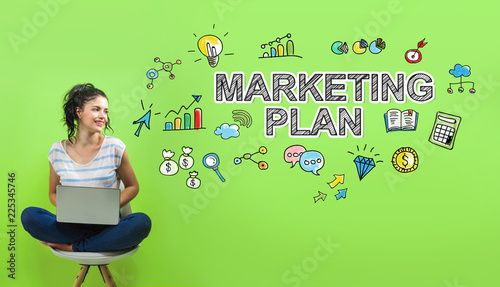 Marketing plan with young woman using a laptop computer