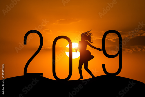 Leinwanddruck Bild Freedom Silhouette woman and 2019 .Concept of a new year.