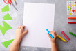 Child draws a pencil drawing empty space colorful grey background top view