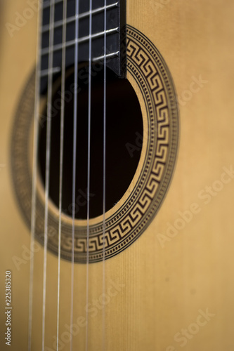 Detail of the acoustic guitar - 225385320