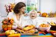 Leinwanddruck Bild - Family cooking pumpkin soup for Halloween lunch