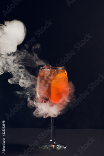 Beautiful cocktail isolated with dry ice smoke. - 225392998