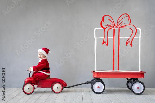 Foto Murales Happy child having fun on Christmas time