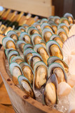 Tasty and delicious mussels close-up on ice. Contain cholesterol, but low in saturated fat and have omega-3 fatty acid, packed with nutrition, vitamin and mineral. Healthy eating and eat well concept. - 225408140