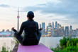 Middle-aged woman practicing yoga at the front of Toronto