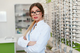 Optician Woman At Eyeglasses Store Portrait - 225452904