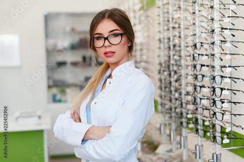 Optician Woman At Eyeglasses Store Portrait