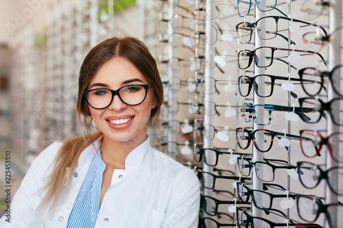 Leinwandbild Motiv Optician Woman At Eyeglasses Store Portrait
