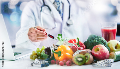 Modern doctor or pharmacy agent contact for healthy food and diet - 225457729