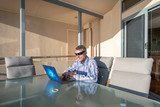 Business man with modern laptop on a terrace table. Relax concept - 225463765