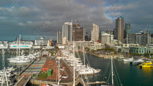 Leinwanddruck Bild AUCKLAND, NEW ZEALAND - AUGUST 26, 2018: Aerial view of cityscape at sunset. More than 1 million tourists visit Auckland annually