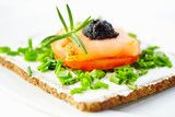 Canape with smoked salmon, soft cheese, tomato and caviar. Symbolic image. Concept for a tasty and healthy meal. Food background. White background. Close up.  - 225464742