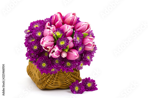 Foto Murales Bouquet made of tulips and chrysanthemum flowers on white background