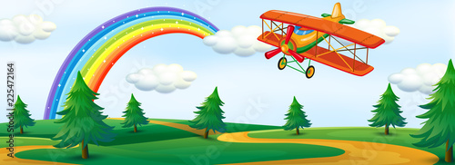 An airplane flying over nature - 225472164