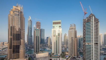 Beautiful aerial top view day to night transition timelapse of Dubai Marina canal