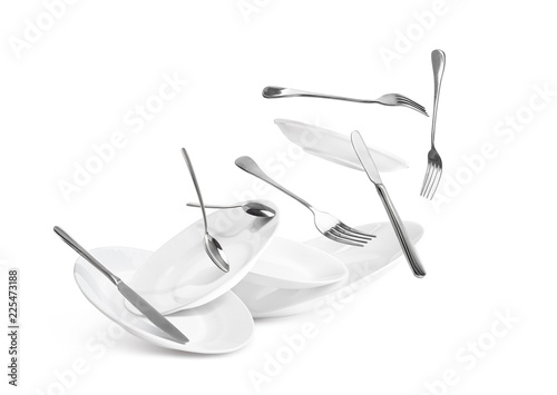 Leinwanddruck Bild Fall of dishes and cutlery isolated on white background