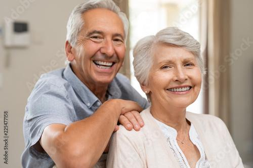 Leinwandbild Motiv Happy senior couple smiling