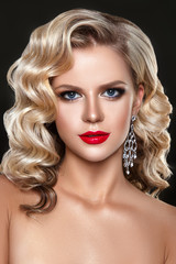 Beautiful woman portrait with evening make up and curly hair style. © demidenko