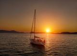 Bare boat during sunrise in Aegean Sea close to Datca Turkey