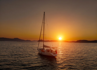 Bare boat during sunrise in Aegean Sea close to Datca Turkey