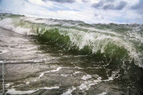 Storm waves on the seashore as a background