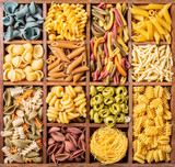 Assorted colorful italian pasta in wooden box. Healthy food background concept. Flat lay, top view. - 225531753