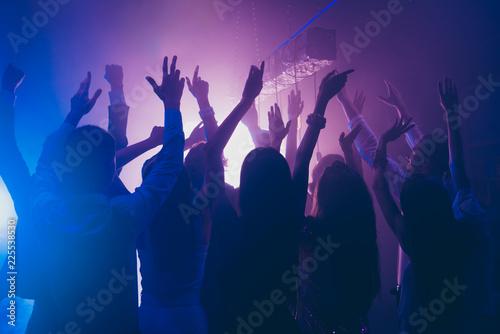 Leinwandbild Motiv Fans rest, relax, chill waving raised hands cheering in night cl