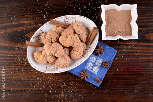 Bowl with cinnamon biscuits and anise -