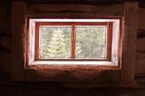A window in the barn. The window in the hut. Wooden window.
