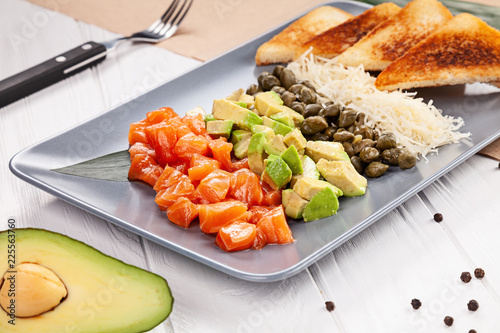 Delicious selective focus on salmon tartare with avocado and toast on white background. Copy space for text, close up view food. - 225563760